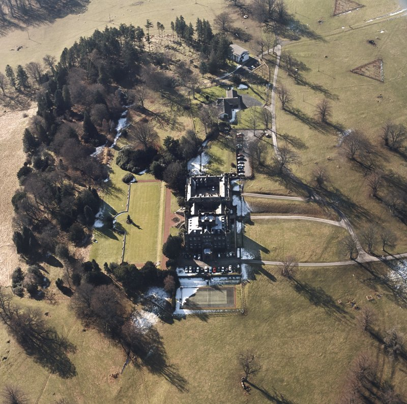 Oblique aerial view, taken from the NE.