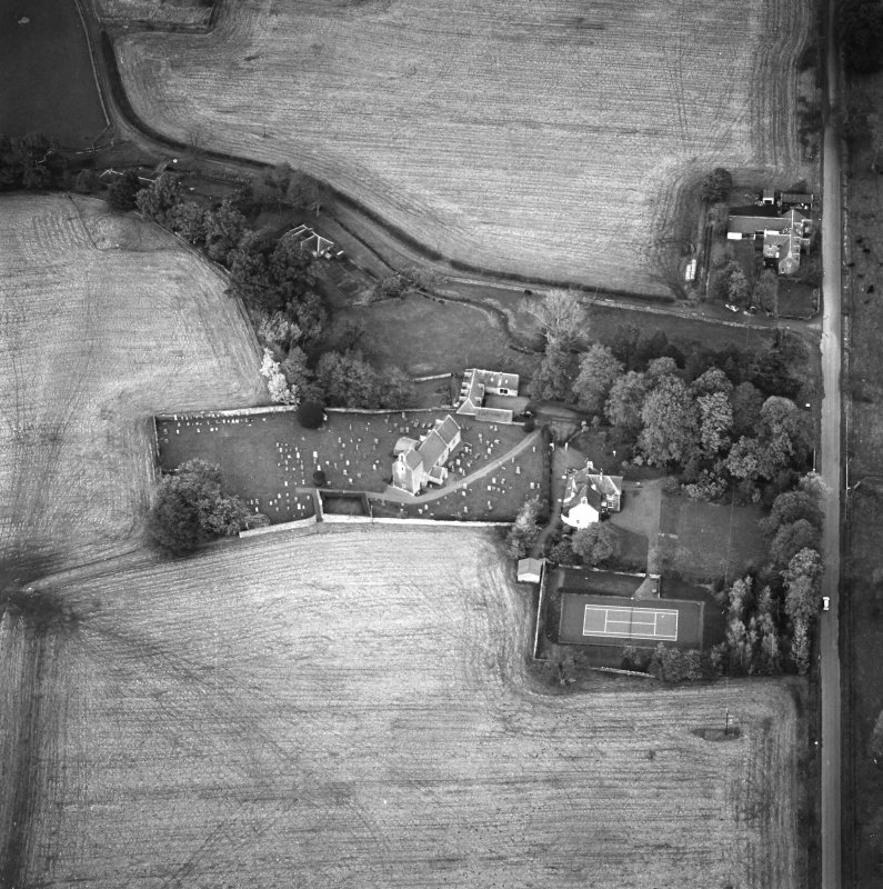 Oblique aerial view of the church and manse, taken from the W.
