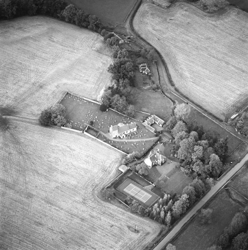 Oblique aerial view of the church and manse, taken from the SW.