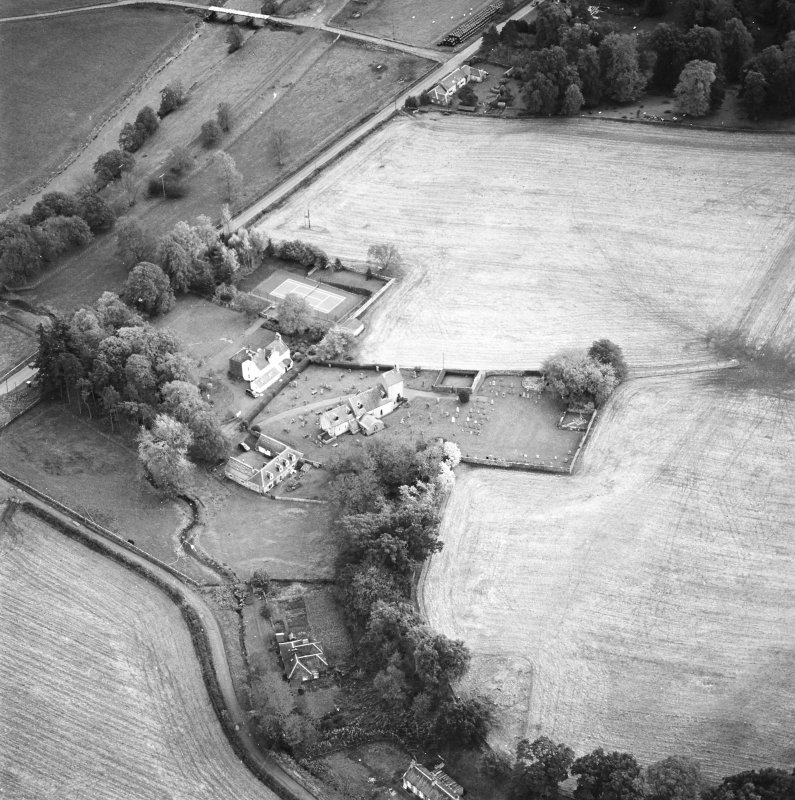 Oblique aerial view of the church and manse, taken from the N.