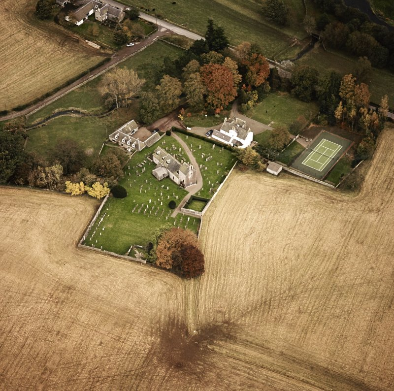 Oblique aerial view centred on the church and manse, taken from the WNW.