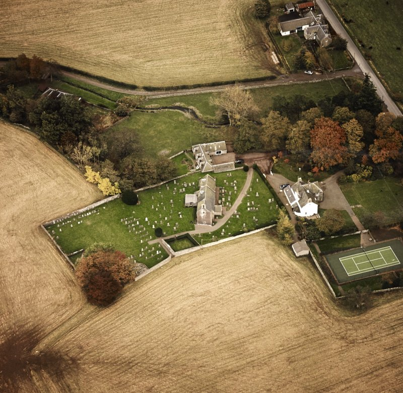 Oblique aerial view centred on the church and manse, taken from the W.