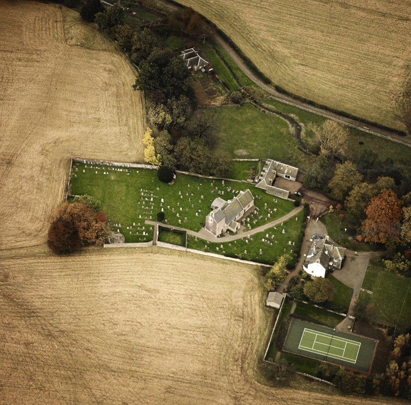 Oblique aerial view centred on the church and manse, taken from the WSW.