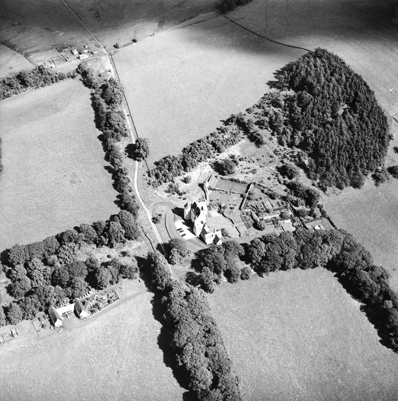 Oblique aerial view centred on the country house with the stables adjacent, taken from the WSW.