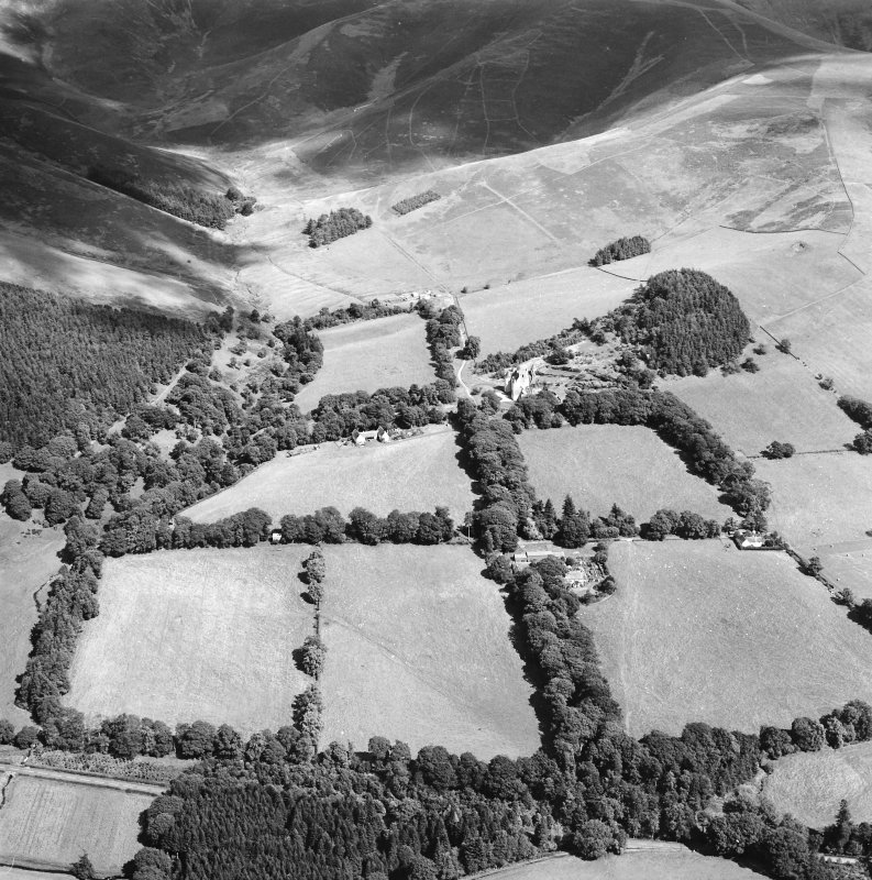 General oblique aerial view looking across the farmsteading towards the country house and stables, taken from the WSW.