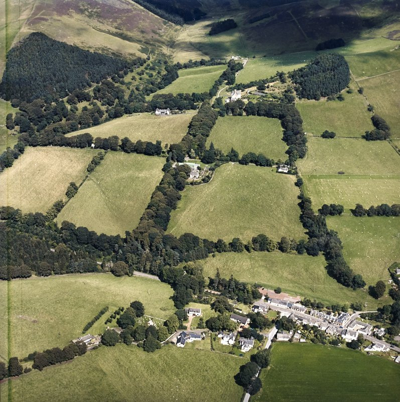 General oblique aerial view looking across the farmsteading towards the country house and stables, taken from the SW.