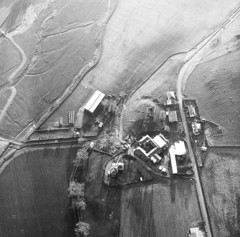 Oblique aerial view centred on tower house from N.