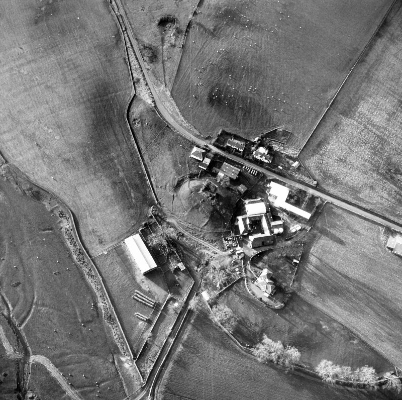 Oblique aerial view centred on tower house from NE.