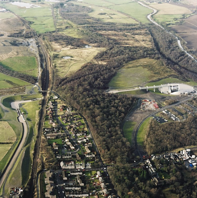 Oblique aerial view of the Falkirk Wheel, lock, and the remains of the Roman fort and Antonine Wall, taken from the E.