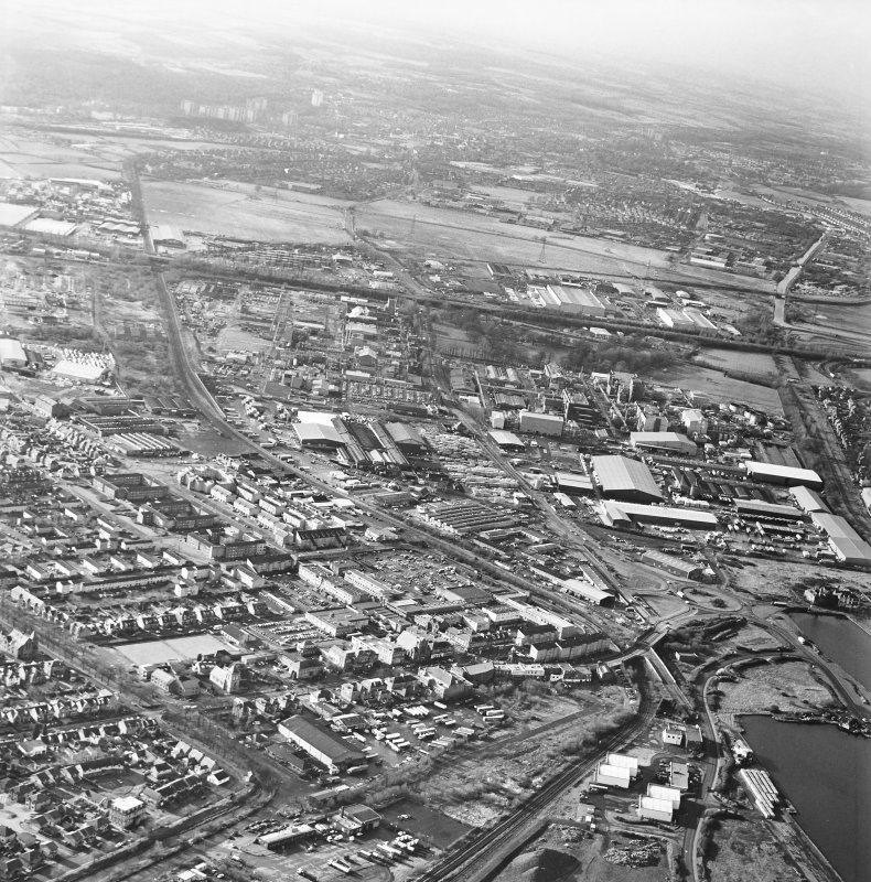 General oblique aerial view looking across the town towards Falkirk, taken from the NE.