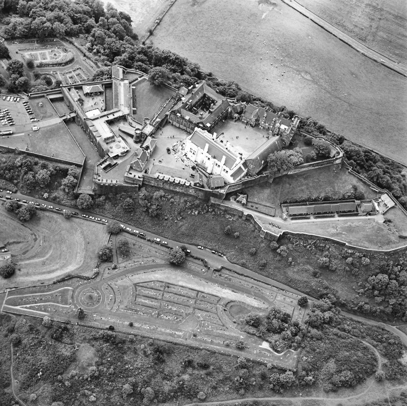 Oblique aerial view centred on the castle, taken from the NE.