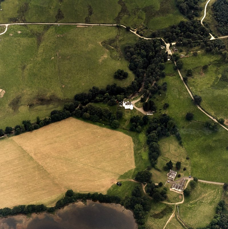 Oblique aerial view centred on the castle with farmstead adjacent, taken from the NW.