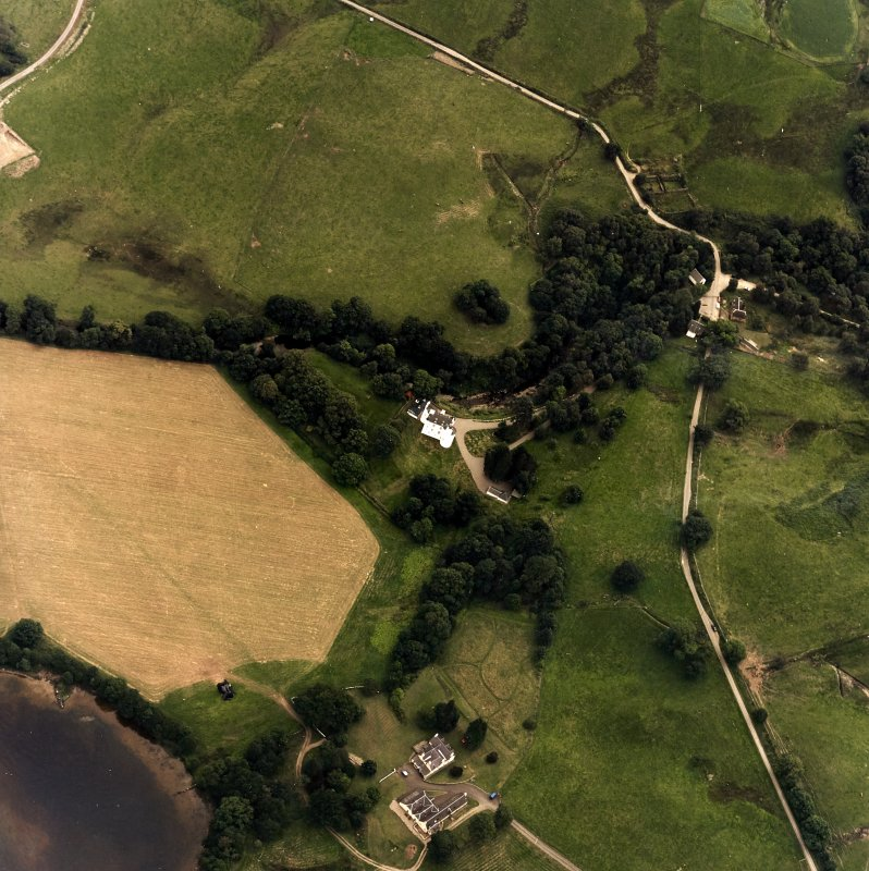 Oblique aerial view centred on the castle with farmstead adjacent, taken from the WNW.