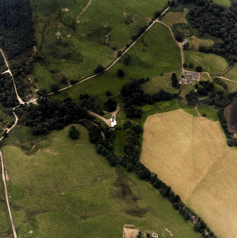 Oblique aerial view centred on the castle with farmstead adjacent, taken from the ENE.