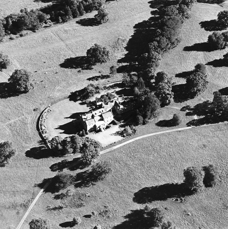 Oblique aerial view centred on the tower-house, taken from the N.
