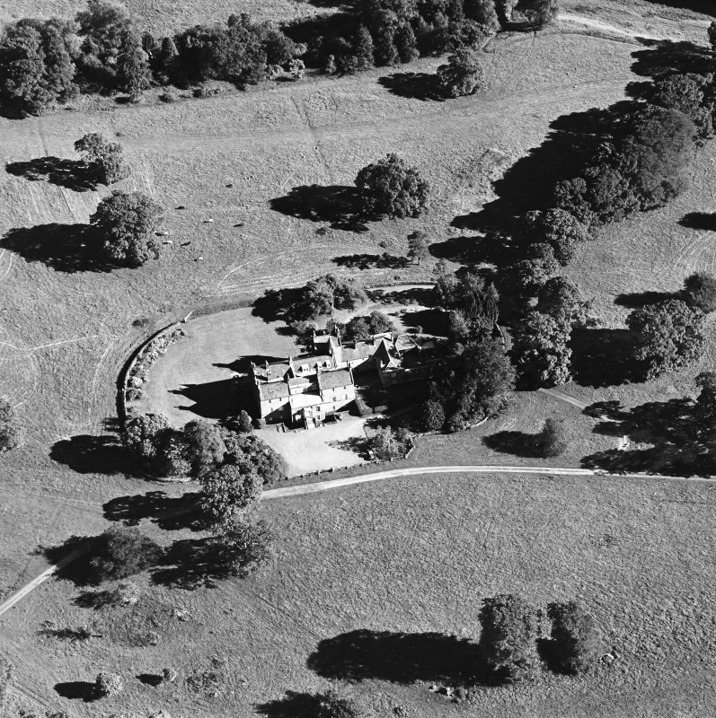 Oblique aerial view centred on the tower-house, taken from the NNW.