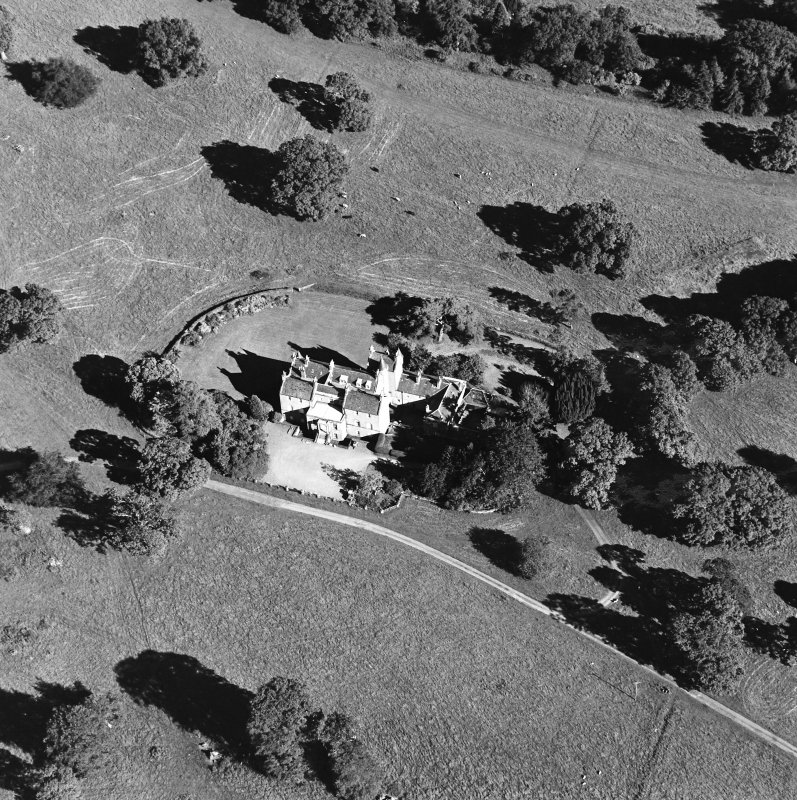 Oblique aerial view centred on the tower-house, taken from the NW.