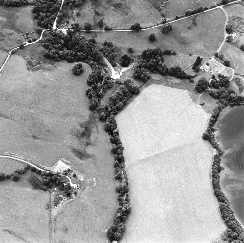 Oblique aerial view centred on the castle with farmstead adjacent, taken from the NE.