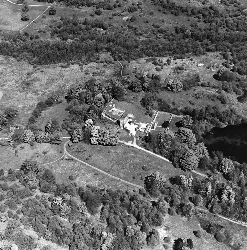 Oblique aerial view centred on the remains of the castle and tower, taken from the S.