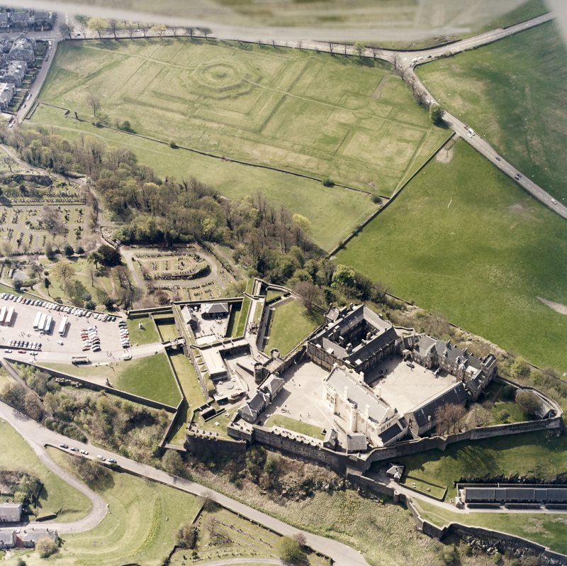 Oblique aerial view centred on the castle with the garden adjacent, taken from the NNE.