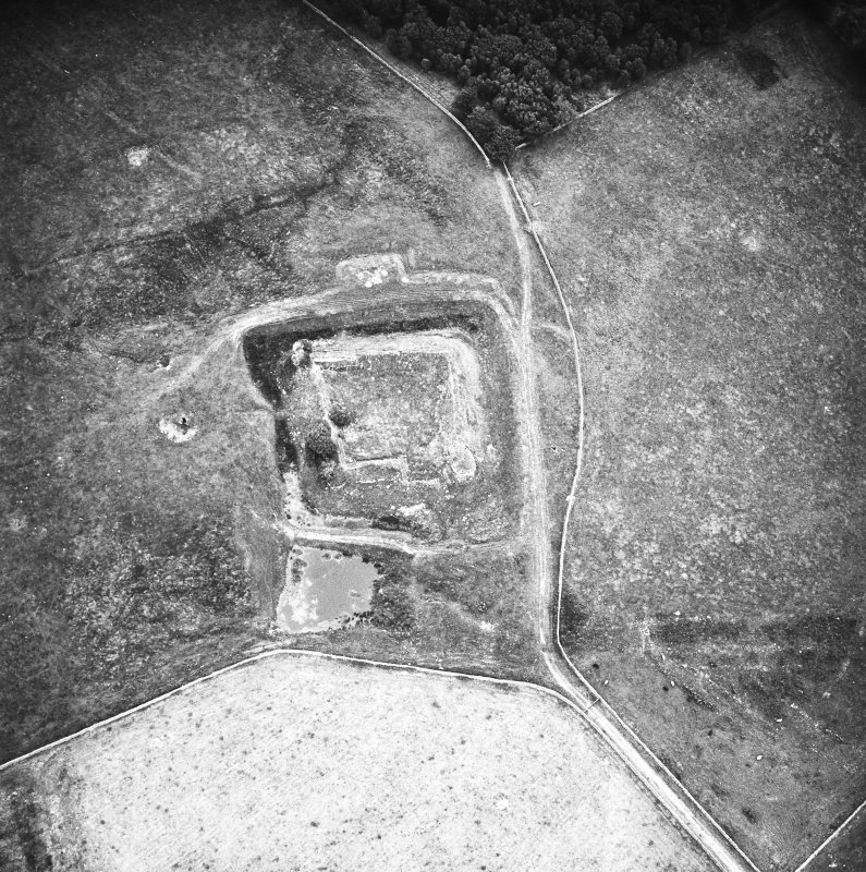Oblique aerial view centred on castle from N.