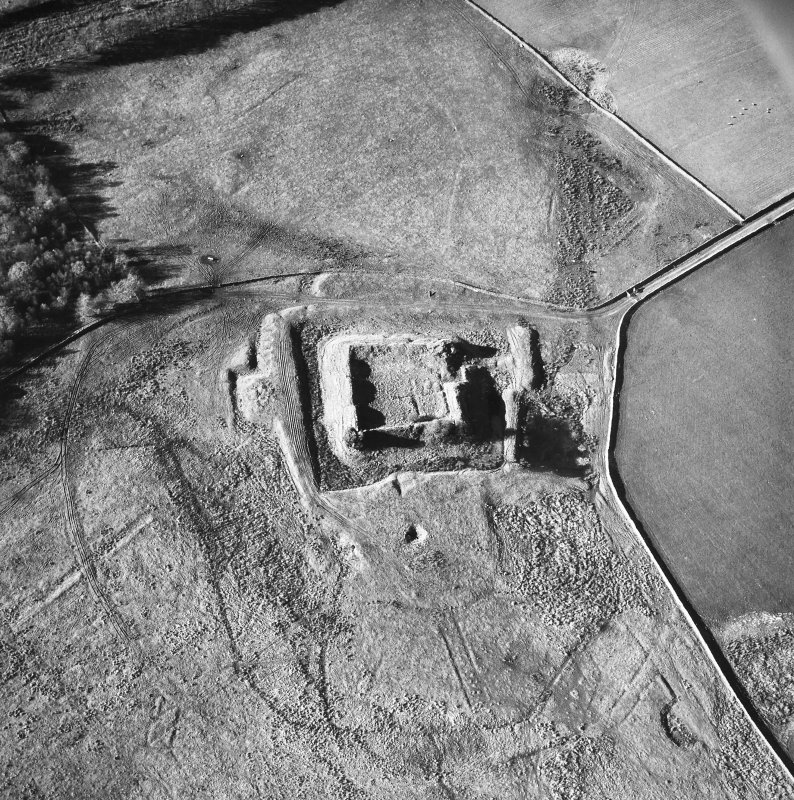 Oblique aerial view centred on castle from E.