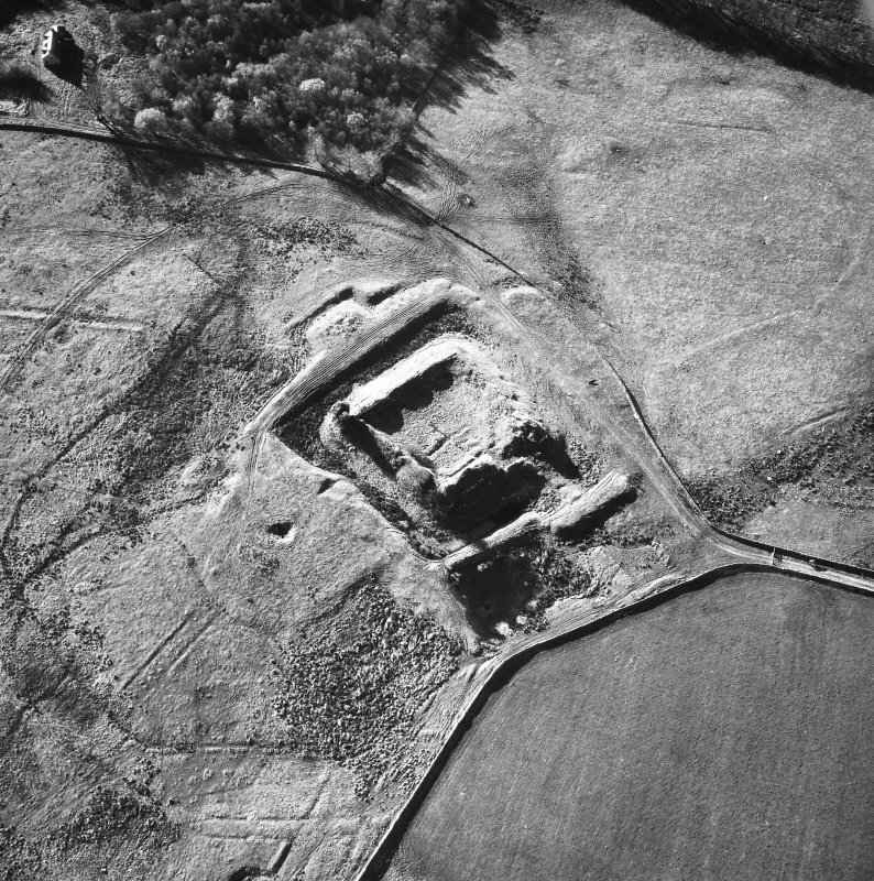 Oblique aerial view centred on castle from NE.