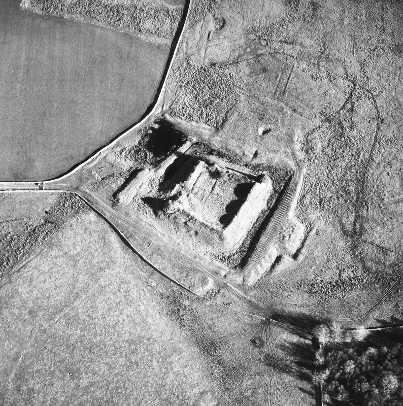 Oblique aerial view centred on castle from SW.