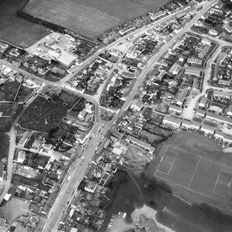 Oblique aerial view centred on town house from SE.