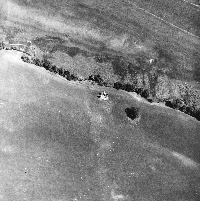 Oblique aerial view centred on tower house from W.