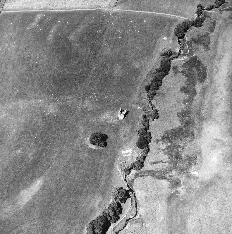 Oblique aerial view centred on tower house from S.