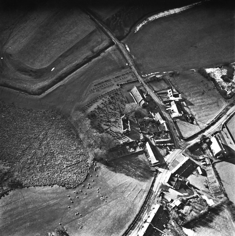 Dalton, oblique aerial view, taken from the ENE, centred on the old parish church and the parish church.  A road bridge is visible in the centre top half of the photograph.