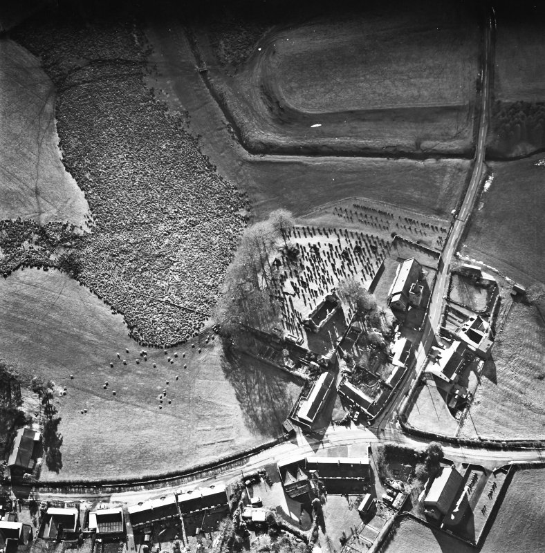 Dalton, oblique aerial view, taken from the NE, centred on the old parish church and the parish church.  A road bridge is visible in the top right hand corner of the photograph.