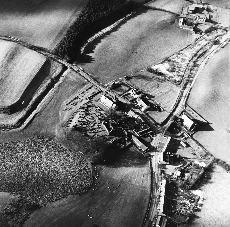 Dalton, oblique aerial view, taken from the ESE, centred on the old parish church and the parish church.  A road bridge is visible in the top left hand corner of the photograph.