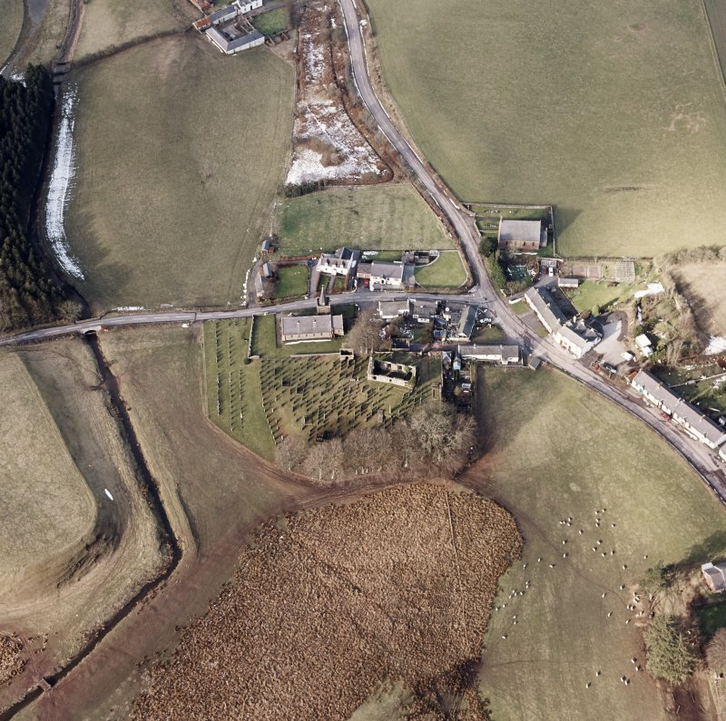 Dalton, oblique aerial view, taken from the SE, centred on the old parish church and the parish church.  A road bridge is visible in the centre left half of the photograph.