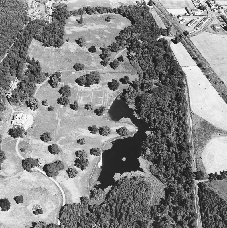Oblique aerial view centred on gardens from S.
