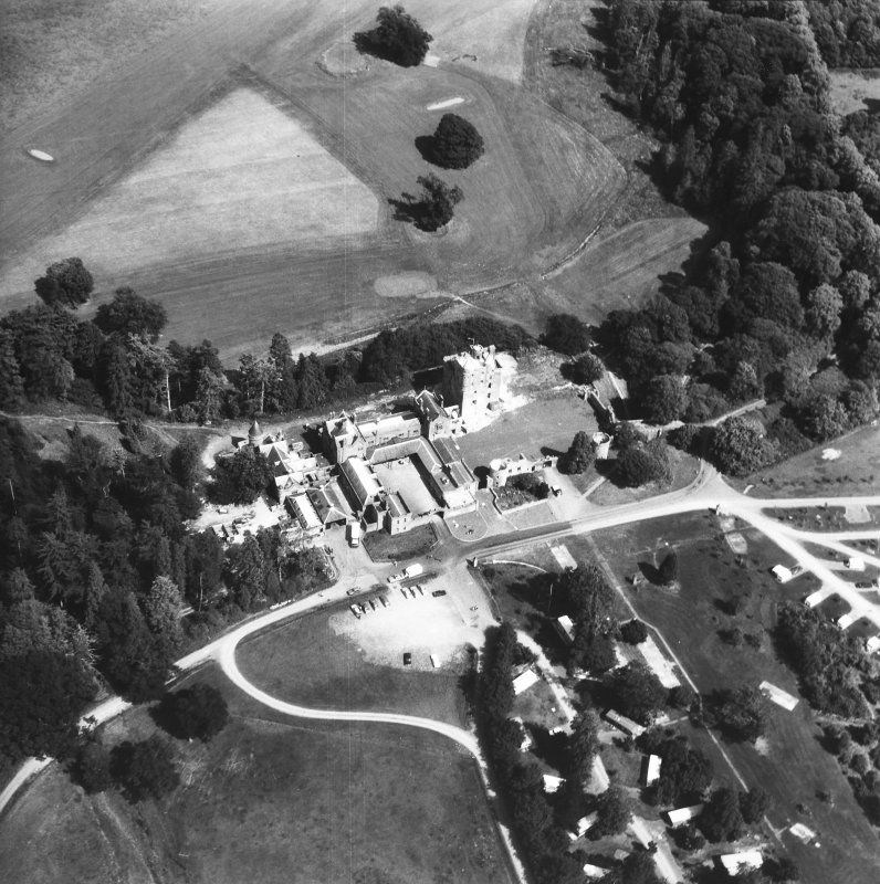 Oblique aerial view of country house from W.