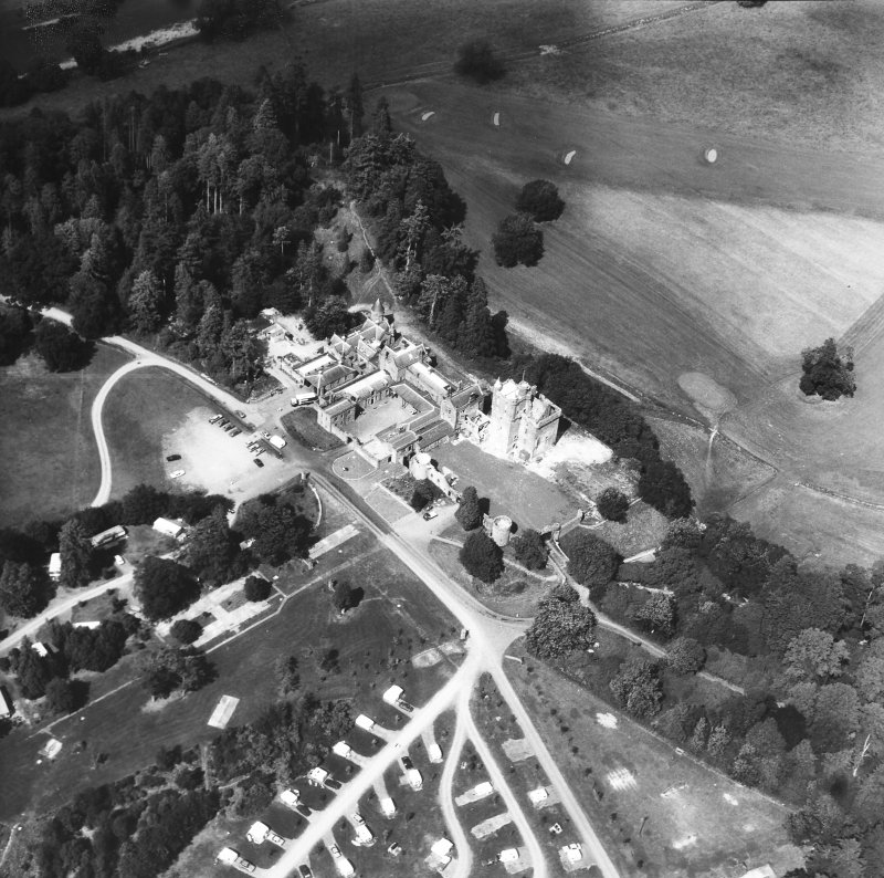 Oblique aerial view of country house from SW.