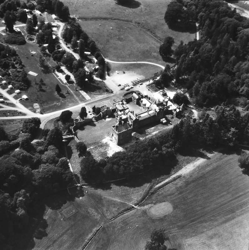 Oblique aerial view of country house from SE.