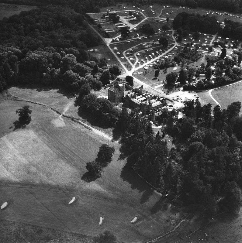 Oblique aerial view of country house from NE.