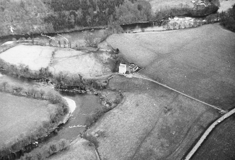 Oblique aerial view centred on tower house from SW.
