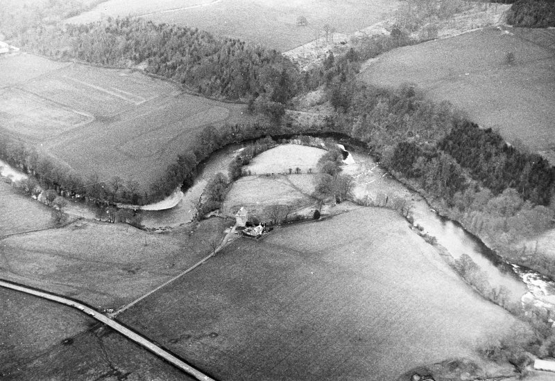 Oblique aerial view centred on tower house from SE.