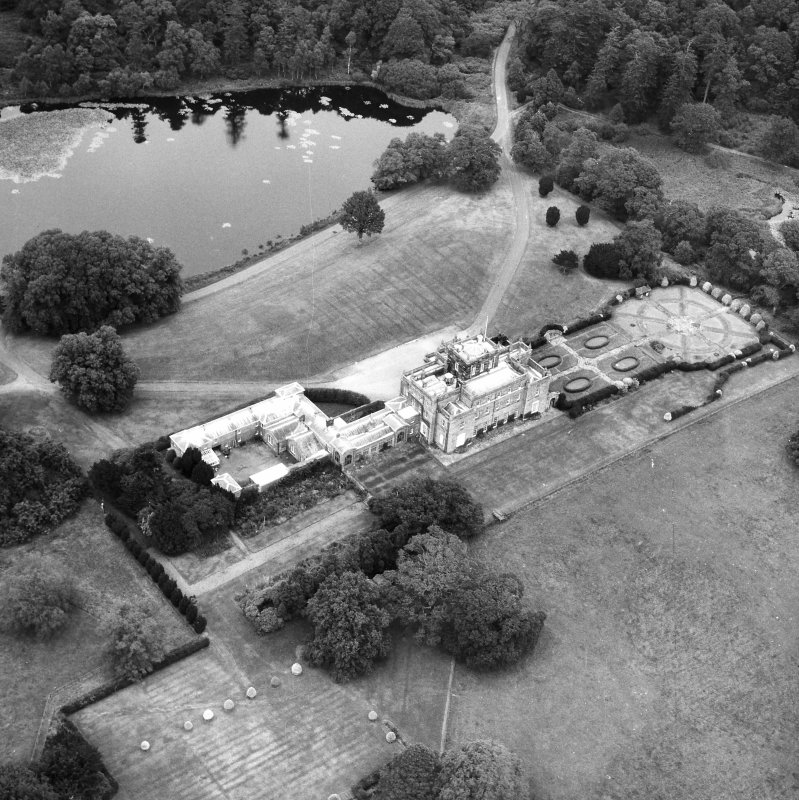 Oblique aerial view centred on country house from SW.