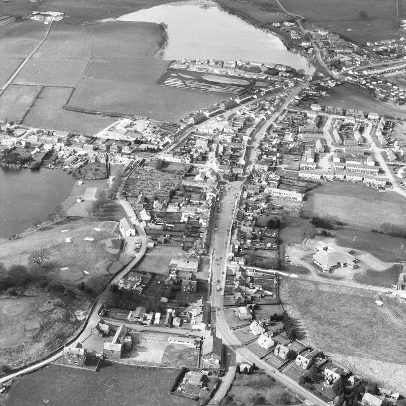 Oblique aerial view centred on town house from S.