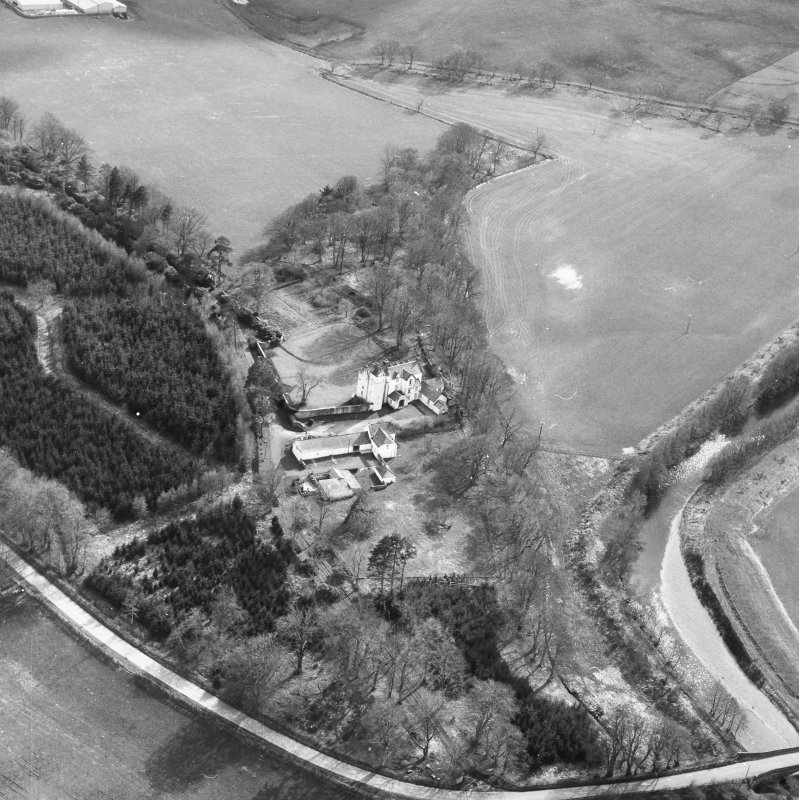 Oblique aerial view centred on country house from NE.