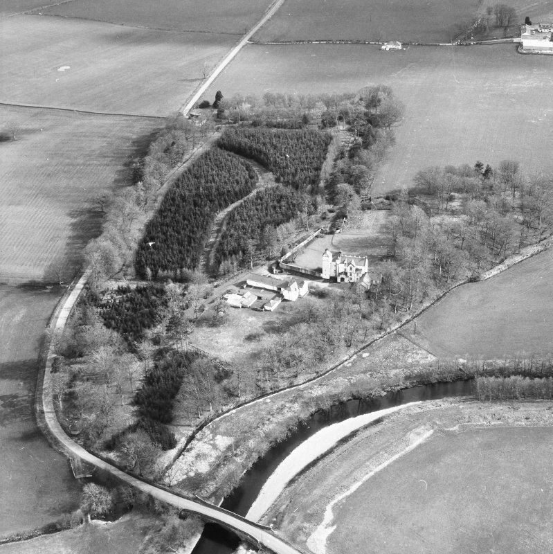 Oblique aerial view centred on country house from N.
