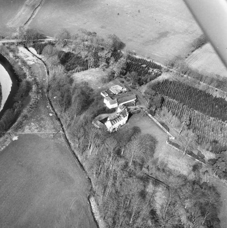Oblique aerial view centred on country house from S.