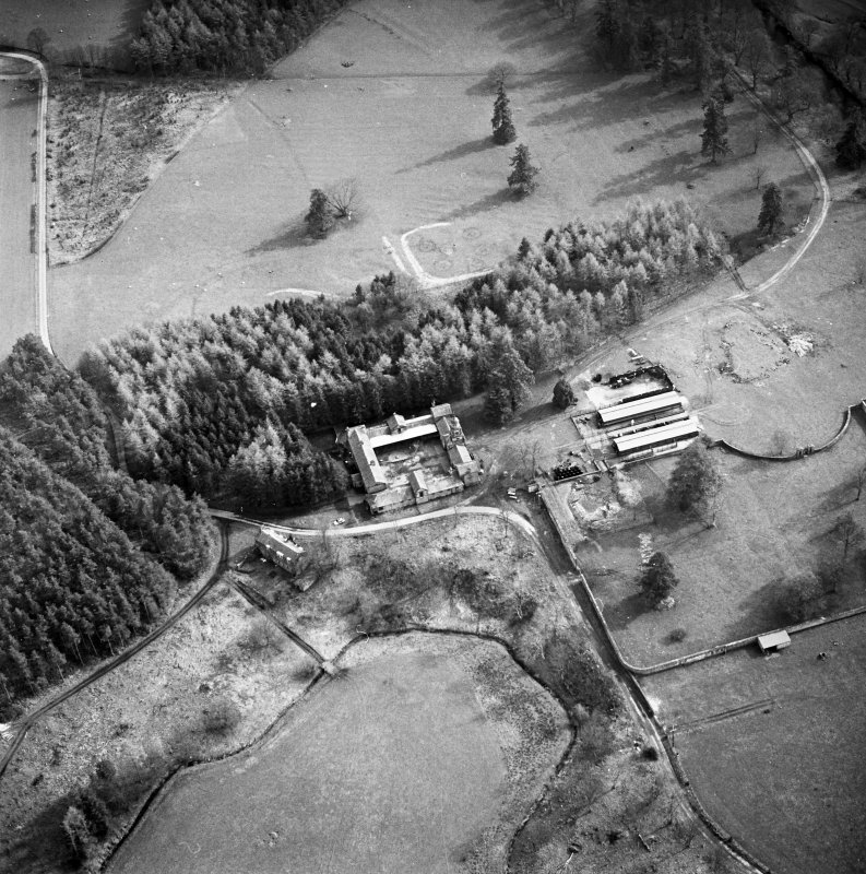 Aerial view of Jardine Hall stables, site of Jardine Hall and walled garden, taken from NNW.  Also a possible field rig, c. 100 876.