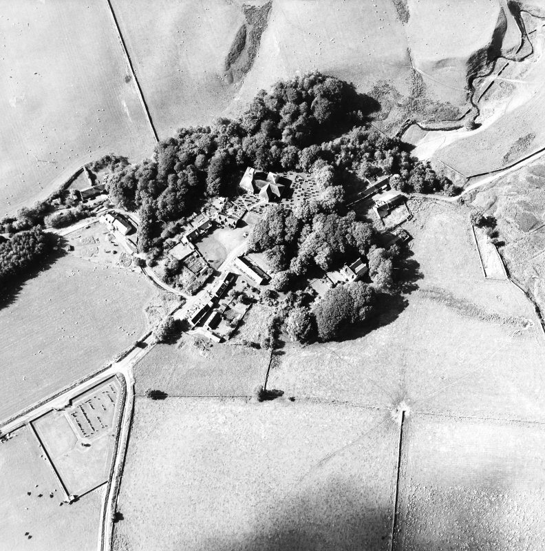 Oblique aerial view from S of village with parish church in the centre.