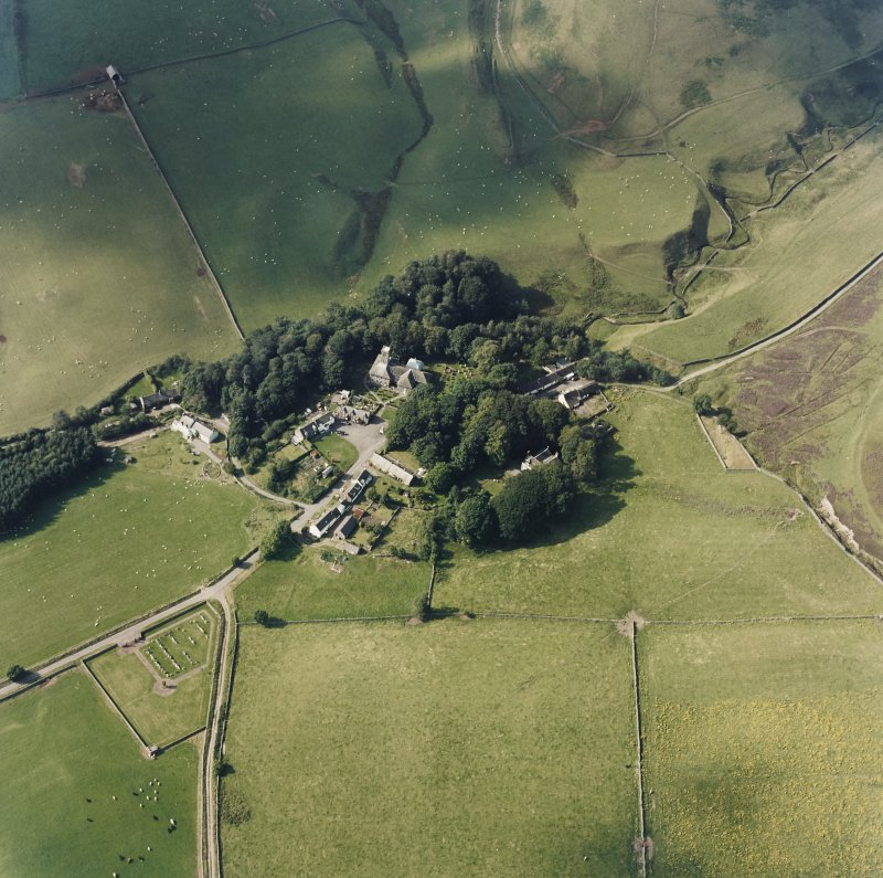 Oblique aerial view from SE of village with the parish church in the centre.